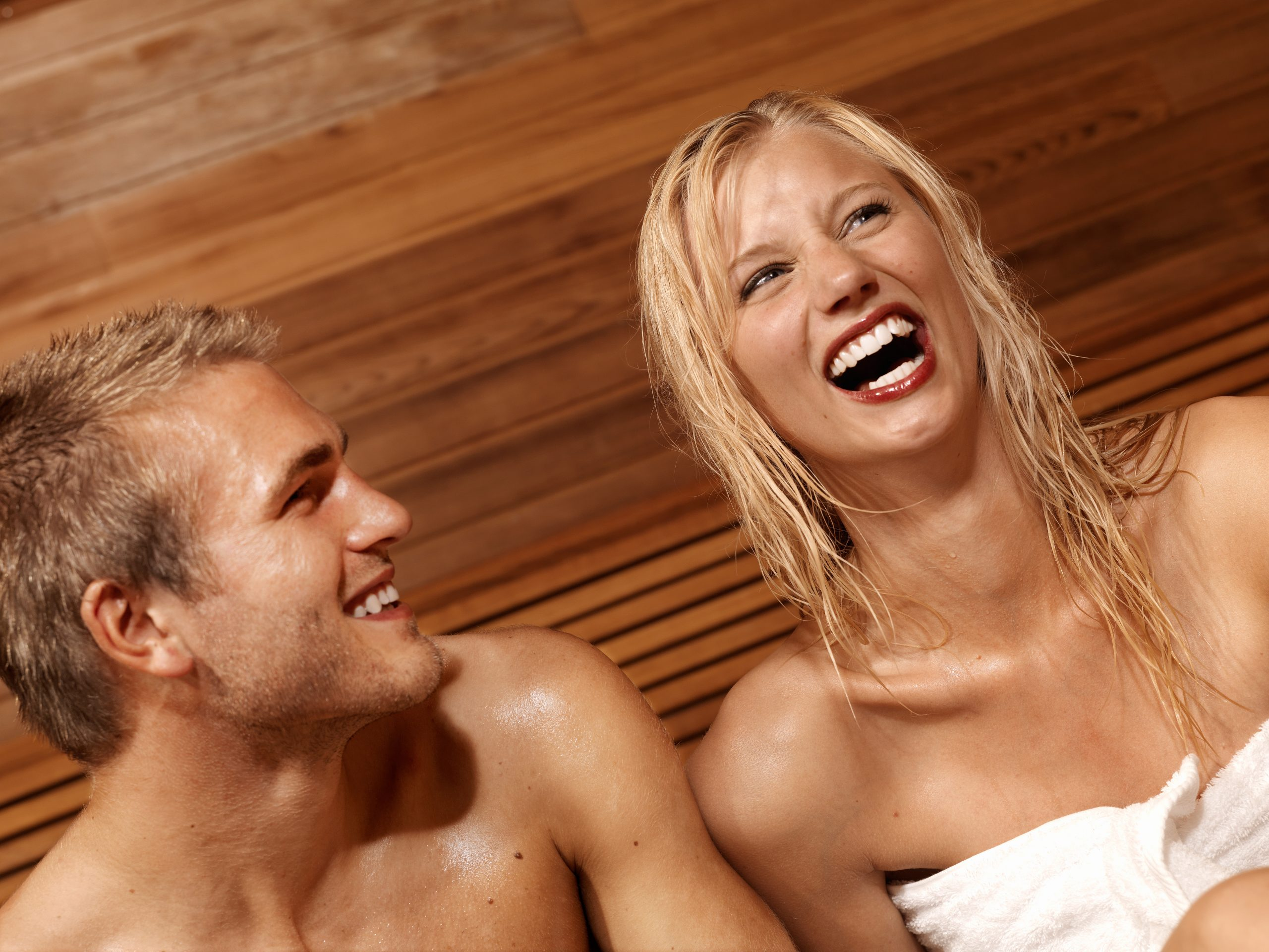 Happy Couple Boosting Their Health by Using a Finnleo Sauna