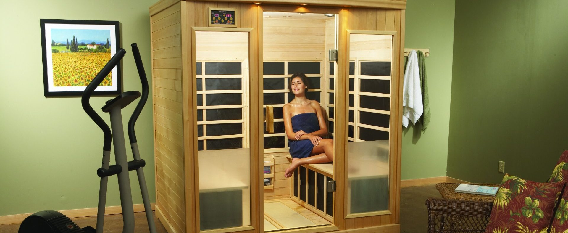 Make 2021 your year of wellness with a sauna. Spend time relaxing while working on health goals, like this woman enjoying her indoor Finnleo sauna.